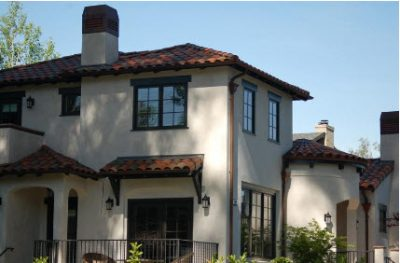 Stucco sided home with clay roof