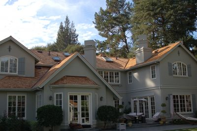 Light grey house with wood natural shingles